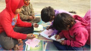 Parusham [red] and other children study and draw at the Verandah Classes